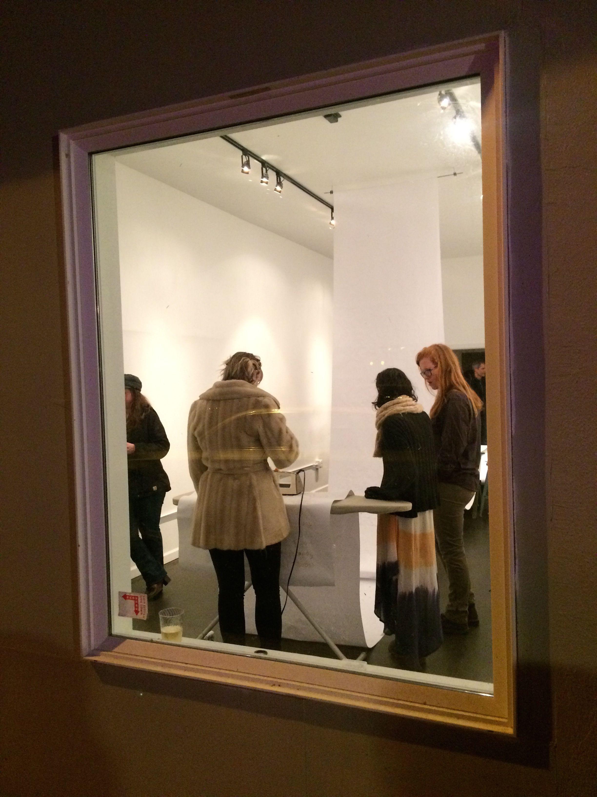 Installation reception - participant ironing