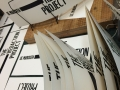 Hand-printed show catalogue covers drying